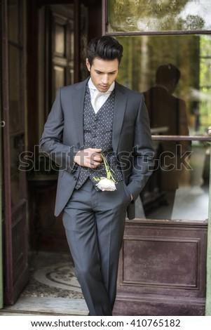 Handsome bridegroom in grey suit - stock photo