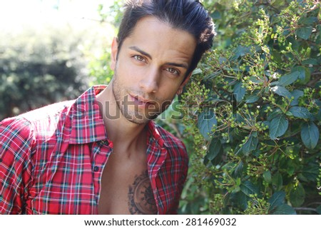 handsome brown man wearing a plaid shirt