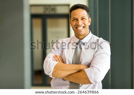 handsome business executive looking at the camera - stock photo