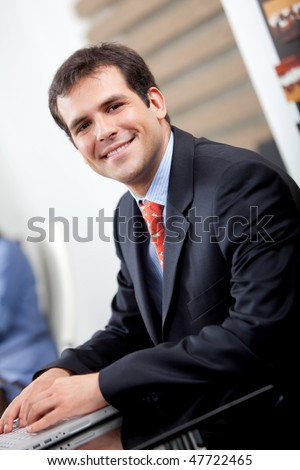 Handsome business man at the office smiling