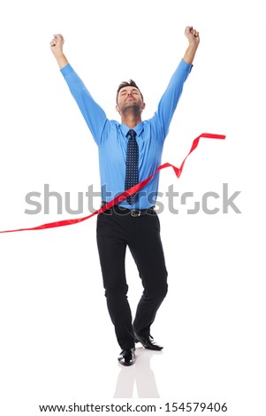Handsome business man crossing the finish line - stock photo