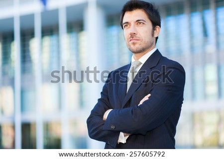 Handsome business man outdoor - stock photo