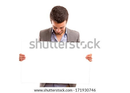 Handsome business man presenting your product - stock photo