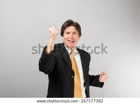 handsome business man screaming of joy