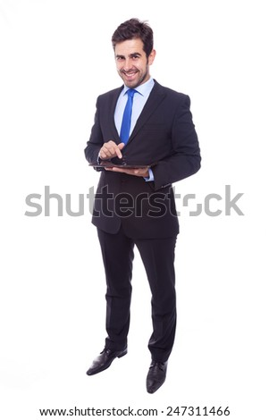 Handsome business man with tablet computer, isolated on a white background - stock photo