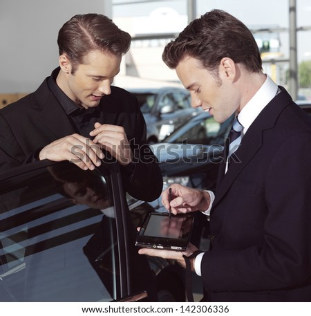 handsome business men with laptop computer