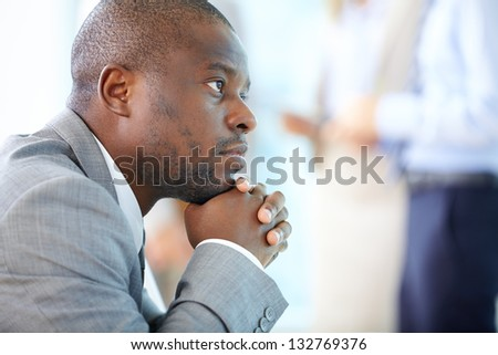 Handsome businessman daydreaming of his business future - stock photo