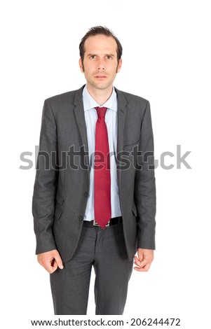 Handsome businessman doing different expressions in different sets of clothes: angry - stock photo