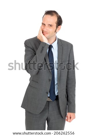 Handsome businessman doing different expressions in different sets of clothes: toothache - stock photo