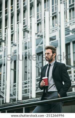 Handsome Businessman Drinking Coffee in a Financial District - stock photo