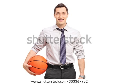 Handsome businessman holding a basketball isolated on white background - stock photo