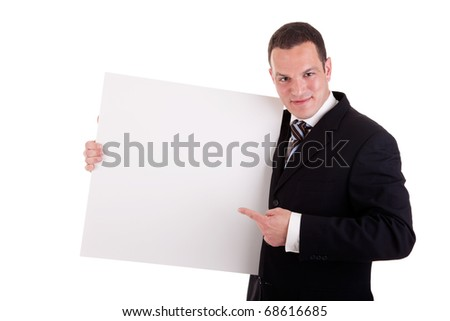 handsome businessman holding a whiteboard and pointing, looking at the camera and smiling, isolated on white, studio shot - stock photo