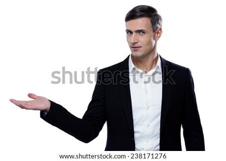 Handsome businessman holding something on a palm  - stock photo