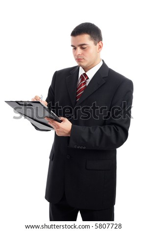 Handsome Businessman in black outfit shot in studio isolated on white - writing on clipboard