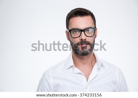 Handsome businessman in glasses looking at camera isolated on a white background