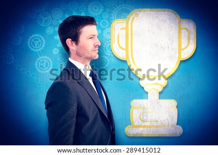 Handsome businessman looking away against blue background - stock photo