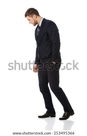 Handsome businessman looking down on the floor. - stock photo