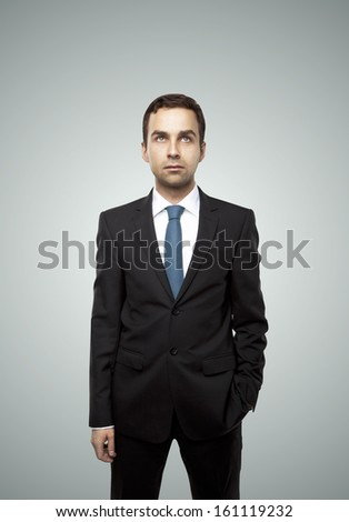 handsome businessman  on a gray background