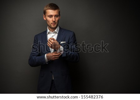 handsome businessman on black - stock photo