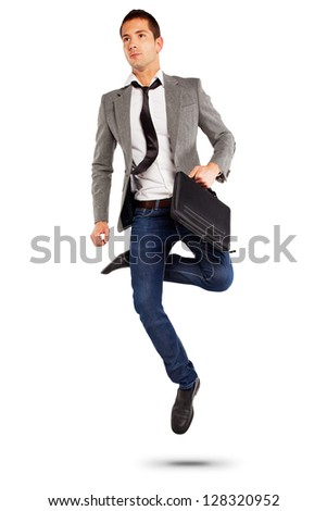 Handsome businessman on grey background. / Young businessman jumping with briefcase