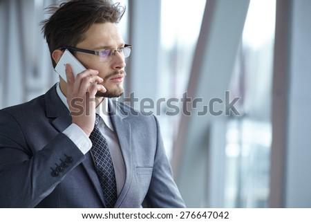 Handsome businessman on the phone - stock photo