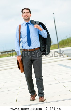Handsome businessman or manager in leisure time going home - stock photo