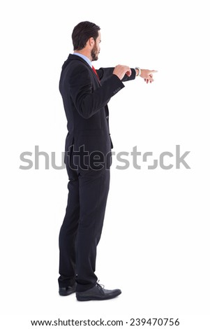 Handsome businessman pointing at something on white background