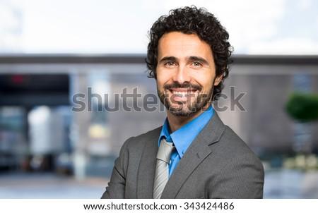 Handsome businessman portrait outdoor - stock photo