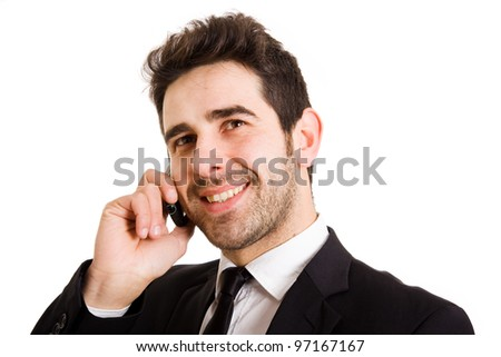Handsome businessman portrait talking at the cell phone isolated on white background - stock photo