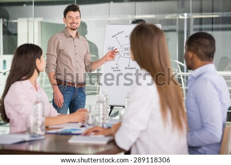 Handsome businessman presenting new project to partners. - stock photo