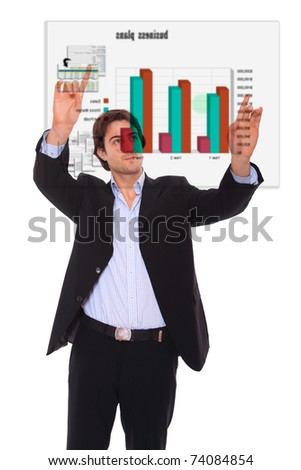 Handsome businessman pressing an abstract touchscreen button isolated on white - stock photo