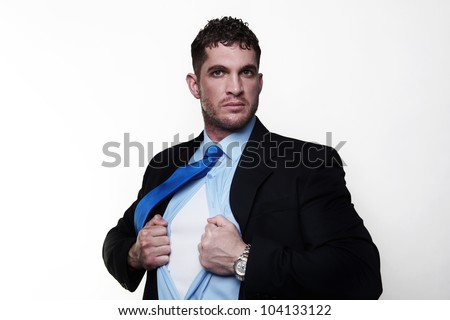 handsome businessman pulling his shirt apart doing a superhero businessman poses - stock photo