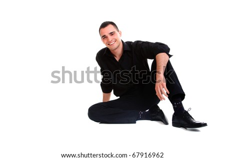 Handsome businessman sitting on the floor . Isolated over white background - stock photo