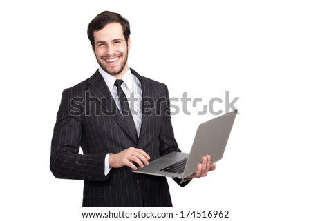 handsome businessman smiling to camera with a gray laptop in his hand, isolated - stock photo
