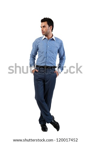 handsome businessman standing with his hands in the pockets - stock photo