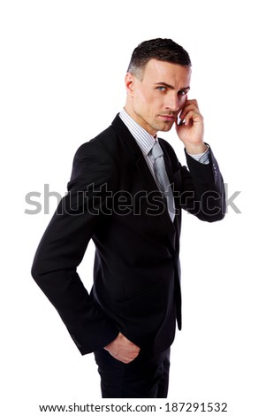 Handsome businessman talking on his mobile phone over white background