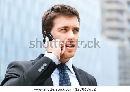 Handsome businessman talking on the cellphone - stock photo