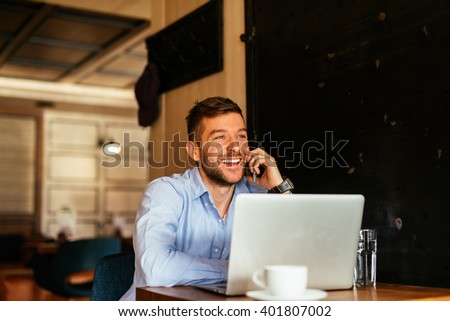 Handsome businessman talking to the clients. - stock photo