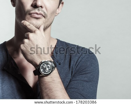 Handsome businessman thinking - stock photo