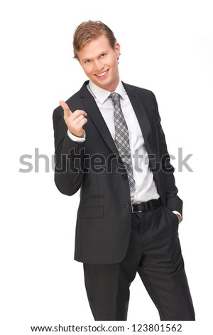 Handsome businessman wearing a suit and tie is pointing his finger at you. He has a smile on his face and hand in his pocket. Isolated on white background