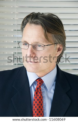 handsome businessman wearing spectacles. - stock photo