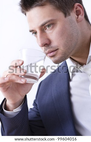 Handsome businessman with glass of water