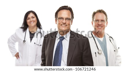 Handsome Businessman with Medical Female and Male Doctors or Nurses Behind Isolated on White. - stock photo