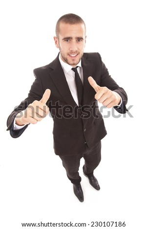 Handsome businessman with thumb up, isolated on white