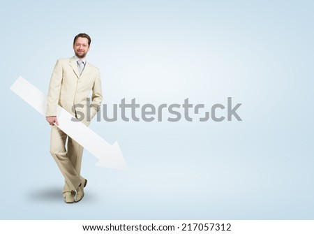 Handsome businessman with white blank arrow. Place for text - stock photo
