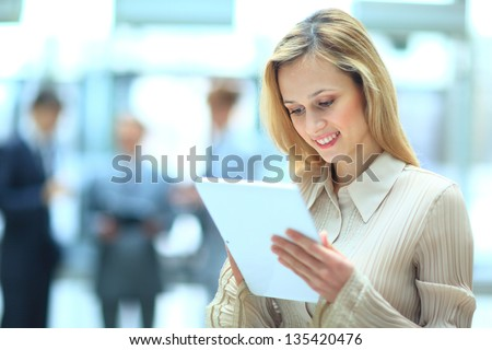 Handsome businesswoman using his digital tablet - stock photo