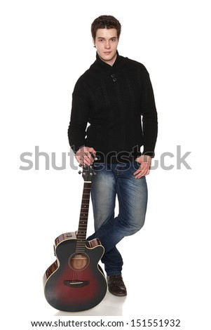Handsome casual man in full length standing with acoustic guitar, isolated on white background. - stock photo