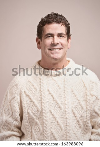 Handsome casual man in wool sweater studio portrait - stock photo