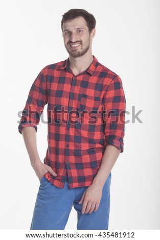 Handsome casual man smiling over a grey background