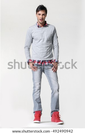 Handsome casual man standing- isolated over a white background